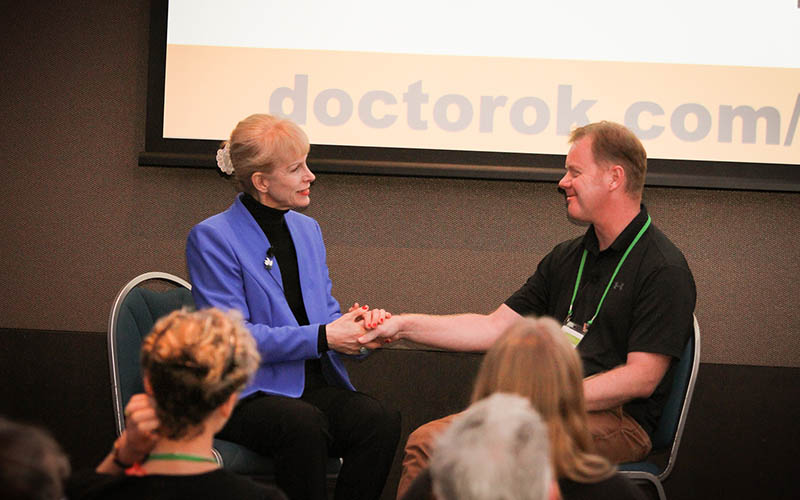 Tracie O'Keefe demonstrating hypnotherapy techniques at a hypnotherapy conference